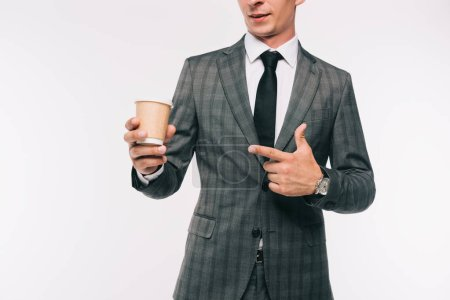 Photo for Cropped image of businessman pointing on coffee in paper cup isolated on white - Royalty Free Image