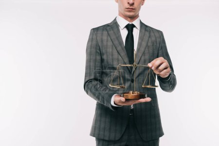 cropped image of businessman holding scales isolated on white