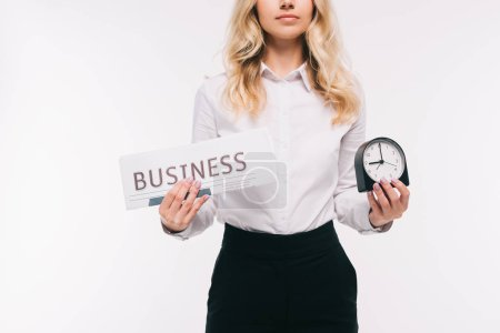 cropped image of businesswoman holding newspaper and clock isolated on white
