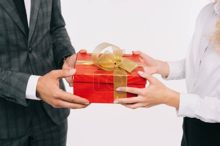 cropped image of businesswoman presenting gift to colleague isolated on white