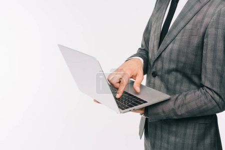 Photo for Cropped image of businessman in suit using laptop isolated on white - Royalty Free Image