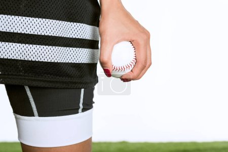 cropped shot of woman holding baseball ball isolated on white