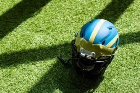 high angle view of american football helmet on green grass