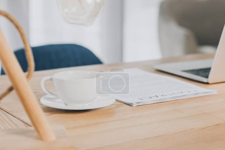Photo for Laptop, documents and cup of tea on wooden table in office - Royalty Free Image