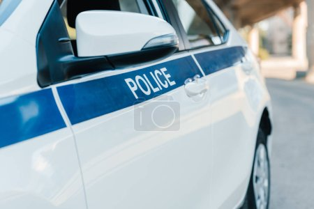 selective focus of automobile with lettering police at city street