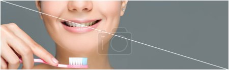 cropped shot of smiling woman holding tooth brush in hand isolated on grey, teeth whitening concept