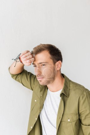 thoughtful man against white wall