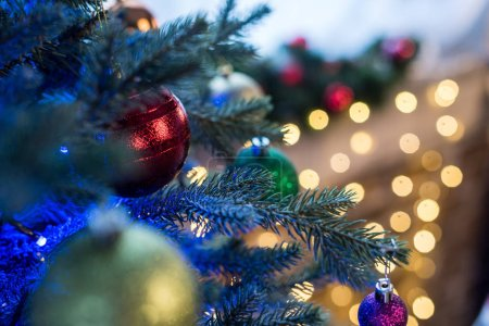 selective focus of beautiful decorated christmas tree with shiny baubles