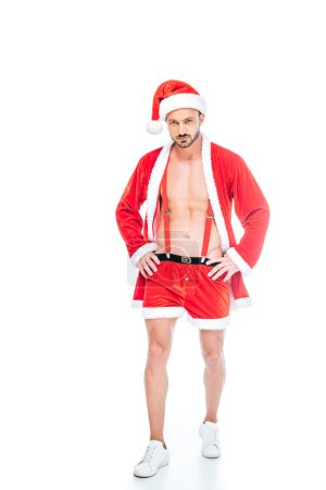 young muscular man in santa claus costume and shorts showing torso isolated on white background