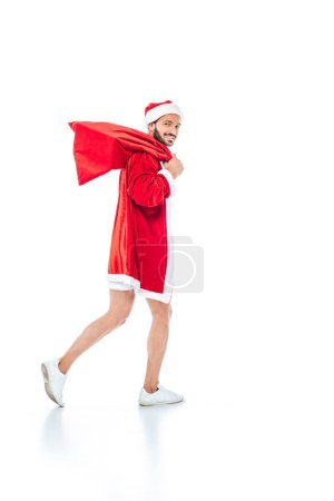 young man in santa claus costume with christmas sack isolated on white background