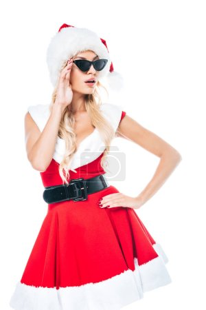 attractive young santa girl in sunglasses looking away isolated on white background