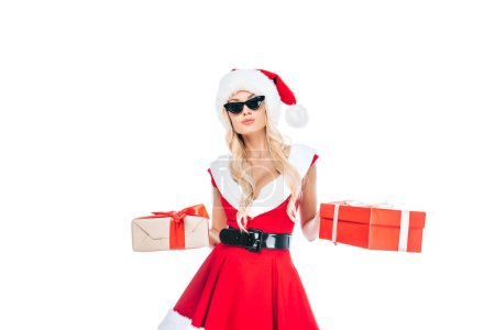 beautiful santa girl in sunglasses holding gift boxes isolated on white background