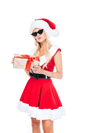 young santa girl in sunglasses holding gift box isolated on white background