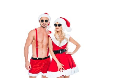 confident couple in christmas hats and sunglasses standing isolated on white background