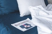 close-up shot of business newspaper lying on bed