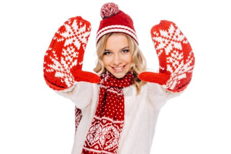Photo for Happy young woman in red mittens smiling at camera isolated on white - Royalty Free Image