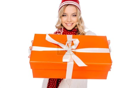close-up view of beautiful smiling young woman holding gift box isolated on white