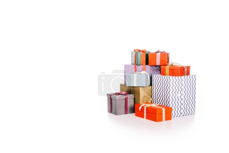 various colorful stacked gift boxes isolated on white