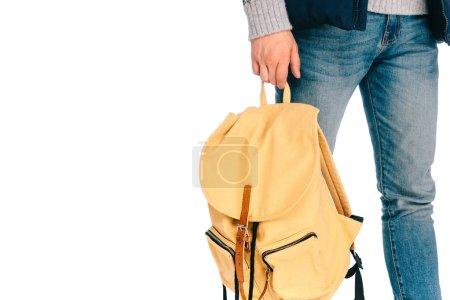 Photo pour Recadrée tir du jeune voyageur tenant le sac à dos isolé sur blanc - image libre de droit