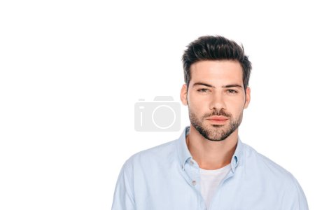 portrait of handsome young man looking at camera isolated on white
