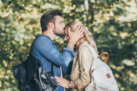 Photo for Side view of romantic couple in autumn park - Royalty Free Image