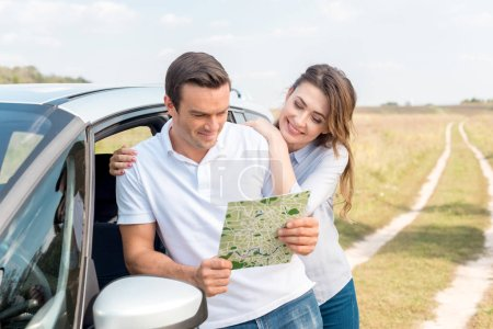 Photo for Happy adult couple navigating with map while travelling by car - Royalty Free Image