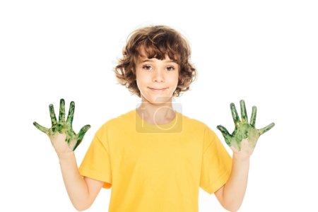Foto de Adorable niño feliz con las manos en pintura colorida sonriendo a cámara aislada en blanco - Imagen libre de derechos