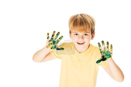 high angle view adorable happy boy with hands in colorful paint smiling at camera isolated on white