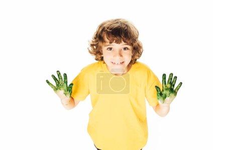 Foto de Alto ángulo de visión adorable niño feliz con las manos en pintura sonriendo a cámara aislada en blanco - Imagen libre de derechos