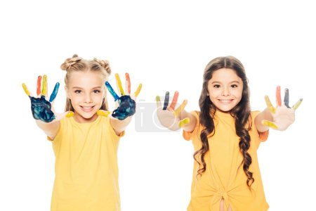 beautiful happy children showing colorful painted hands and smiling at camera isolated on white