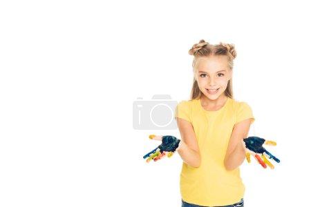 Foto de Lindo niño feliz mostrando coloridas pintadas las manos y sonriendo a cámara aislada en blanco - Imagen libre de derechos
