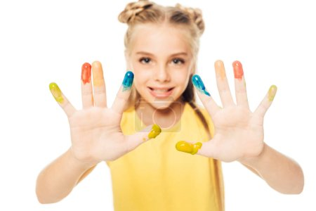 happy child showing colorful painted hands and smiling at camera isolated on white