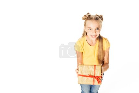 high angle view of beautiful happy child holding present and smiling at camera isolated on white