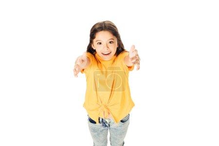 Photo pour Vue d'angle élevé d'adorable gamin heureux atteignant des mains et souriant à la caméra isolé sur blanc - image libre de droit