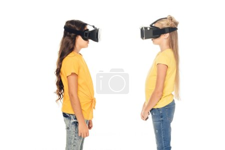 side view of cute kids using virtual reality headsets isolated on white