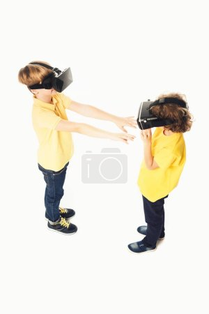 high angle view of kids using virtual reality headsets isolated on white