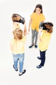 high angle view of children using virtual reality headsets isolated on white