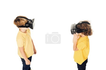 high angle view of boys using virtual reality headsets isolated on white