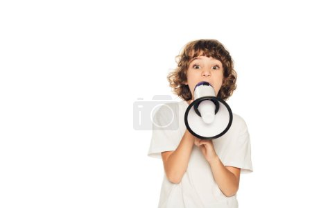 adorable child yelling in megaphone and looking at camera isolated on white