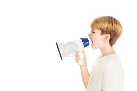 side view of adorable little boy screaming in megaphone isolated on white
