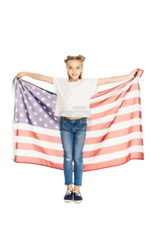 smiling adorable kid holding american flag and looking at camera isolated on white