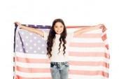 smiling adorable preteen kid holding american flag and looking at camera isolated on white