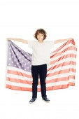 adorable preteen boy holding american flag and looking at camera isolated on white
