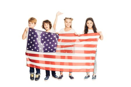 smiling adorable kids holding american flag and looking at camera isolated on white