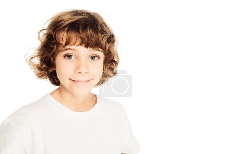 adorable cheerful boy with curly hair looking at camera isolated on white