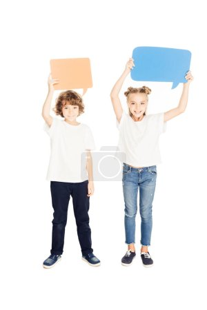 Photo for Cheerful adorable children holding paper speech bubbles above heads isolated on white - Royalty Free Image