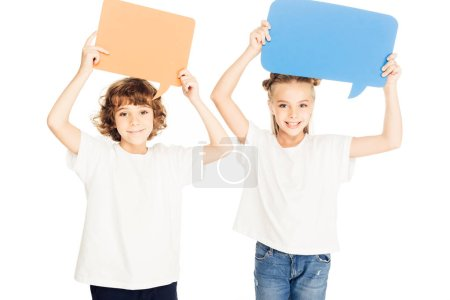 Photo for Adorable smiling children holding paper speech bubbles above heads isolated on white - Royalty Free Image
