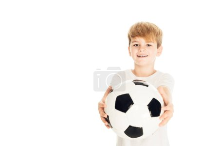 Photo for Smiling adorable boy showing football ball isolated on white - Royalty Free Image