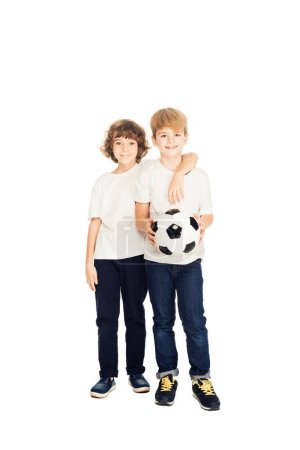 adorable boys hugging and holding football ball isolated on white