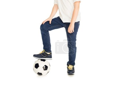 cropped image of boy putting leg on football ball isolated on white